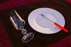 Clean cutlery on the serving table at sunset before dinner Royalty Free Stock Photos