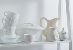 Clean dishes and vases on wooden shelf Royalty Free Stock Photography