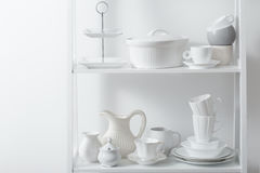 Clean dishes and vases on  wooden shelf Stock Photography