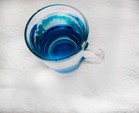 Clean drinking water with bubbles in a clear blue glass. Quench your thirst, water supply problems in arid regions stock photography