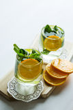 Clean drinking water with orange and mint. Selective focus. Top view Stock Image