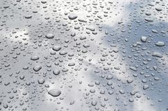 Clean drop on car. Blue water drop on car Stock Image