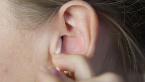 Clean the ear with a stick. stock video footage