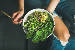 Clean eating breakfast with spinach, arugula, avocado, seeds and sprouts Stock Photos