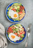 Clean eating concept breakfast with fried egg, chickpea, vegetables, seeds Royalty Free Stock Images
