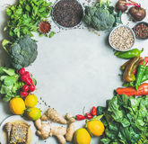 Clean eating healthy cooking ingredients over grey marble background. Clean eating healthy cooking ingredients. Vegetables, beans, grains, greens, fruit, spices Stock Photo