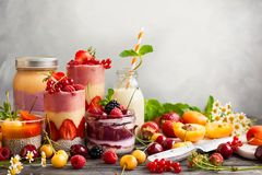 Fruit berry smoothie. Clean eating ideas for breakfast or snack. Assortment of  berry fruit  smoothies, juices and chia seeds pudding. Concept of healthy eating Stock Photography