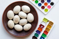 Clean eggs with paints on background.  stock photo
