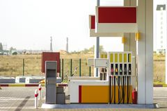 Clean empty auto gas station exterior on sunny day on rural landscape and bright sky copy space background.  royalty free stock images