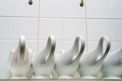 Clean empty ceramic sauce boats in restaurant. Close up empty white ceramic gravy boats in restaurant stock images
