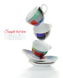 Clean empty colorful plates and cups Stock Photos