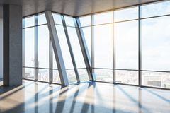 Clean empty office interior. With concrete floor, panoramic city view, sunlight and shadows. 3D Rendering royalty free illustration