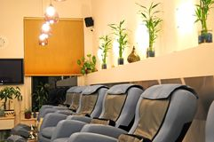 Clean and empty Spa. Relaxing spa blue chairs and bamboo plants royalty free stock photos