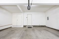 Clean Empty Two Car Garage. In modern suburban home Royalty Free Stock Images