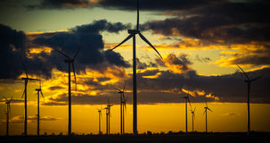 Clean energies. Putting Sun with wind generator, wind energy royalty free stock photography