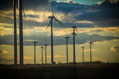 Clean energies. Putting Sun with wind generator, wind energy royalty free stock photos