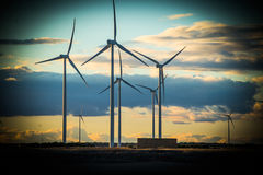 Clean energies. Putting Sun with wind generator, wind energy royalty free stock photo