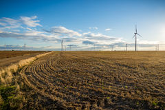 Clean energies. Putting Sun with wind generator, wind energy stock photography