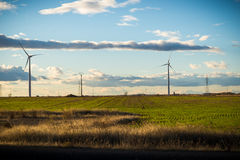 Clean energies. Putting Sun with wind generator, wind energy stock image