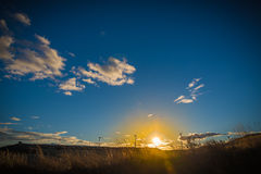 Clean energies. Putting Sun with wind generator, wind energy royalty free stock images