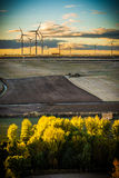 Clean energies. Putting Sun with wind generator, wind energy stock photo