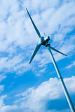 Clean energy. White wind turbine in europe Royalty Free Stock Image