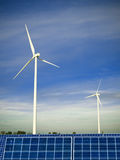 Clean energy. Wind farm and solar panels, symbols of environmetal conservation Royalty Free Stock Image