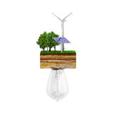 Clean energy concept The bulb is connected to a clutch of ground. With a windmill and a solar battery 3d Royalty Free Stock Image
