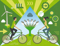 Clean energy with man and woman in bicycle Royalty Free Stock Images