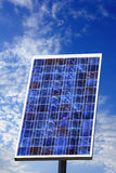 Clean energy with photovoltaic solar panel. Photovoltaic solar panel with a cloudy sky on background Royalty Free Stock Photography