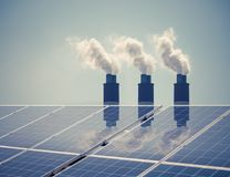 Clean energy with pollution. Roof solar panels reflected thermal power station exhaust steam Stock Photography