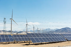 Clean energy on snow area plateau. Solar panels and wind power farm in golmud, China Stock Photo