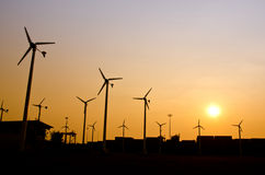 Clean energy wind turbine silhouettes at sunset Stock Photography