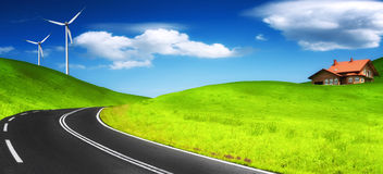 Clean environment. Road, new house and wind turbine Royalty Free Stock Images
