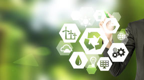 Clean environment. Hand drawing signs of different green sources of energy in hexahedron shape, a 'reduce, reuse, recycle' sign in the centre. Blurred green Royalty Free Stock Photos