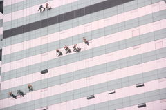 Clean the external walls of the workers in SHENZHEN LUOHU Stock Images