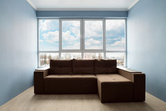 Clean family room with brown couch Royalty Free Stock Photos