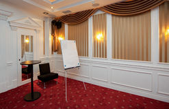 Clean flipchart in luxury conference room Royalty Free Stock Image