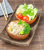 Clean food, fried rice with vegetable, meat and egg. Khao Pad; clean food, fried rice with vegetable, meat and egg served on wooden bowl and side bowl of fresh Royalty Free Stock Images
