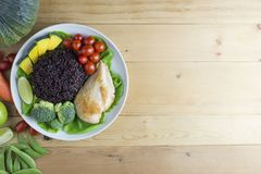 Clean food top view on wood table on disk have vegetable and chicken Royalty Free Stock Images