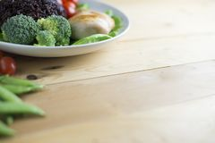 Clean food top view on wood table on disk have vegetable and chicken Stock Image