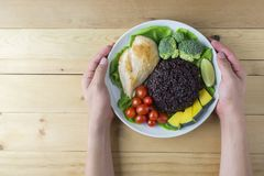 Clean food top view on wood table on disk have vegetable and chicken Royalty Free Stock Photography