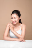 Clean fresh skin concept. Young asian woman touching her shoulde. R Stock Photo