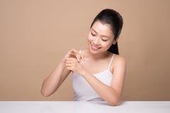 Clean fresh skincare concept. Young asian woman touching enjoyin. G hand skin Royalty Free Stock Photos