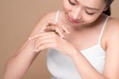Clean fresh skincare concept. Young asian woman touching enjoyin. G hand skin Stock Photography