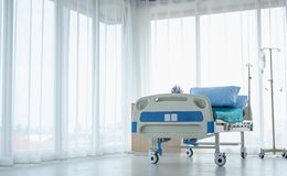 Clean and fully equipped hospital room. This is a standard bed for sick patients . Emergency case can be admitted stock photos