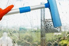 Clean the glass with cleaning equipment. In home royalty free stock photography
