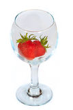 Clean glass with fresh strawberry. The clean glass with red fresh strawberry Stock Photography