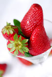 The clean glass with fresh strawberry Royalty Free Stock Images