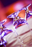 Clean Glasses Upside Down. Three glasses upside down on a bar Royalty Free Stock Photography